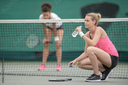 healthy tennis player thirsty drinking water