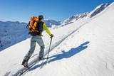 Male ski tourer hiking in the alps