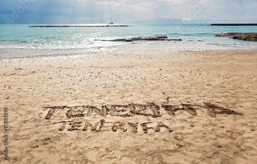 Foto op Canvas Canarische Eilanden Handwritten sign on the gold sand - Torviscas Beach in Costa Adeje, Tenerife - Canary Islands.