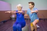 old woman doing physical therapy on the ball