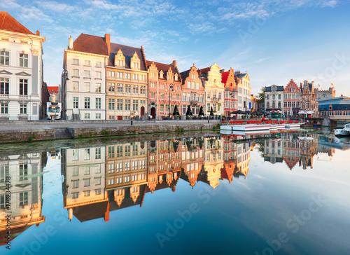 Gent, Belgium. Sunrise in historical center of Ghent reflecting in water of river Leie Flanders, Belgium.