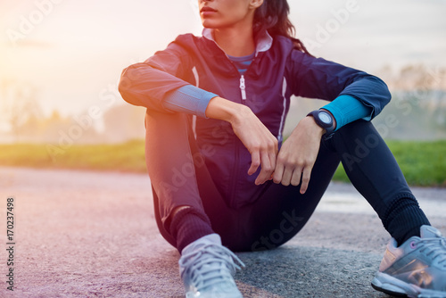 Fotobehang Fitness Athletic woman resting on ground