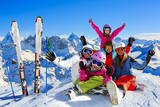 Happy family enjoying winter vacations in mountains . Ski, Sun, Snow and fun. - 170250235