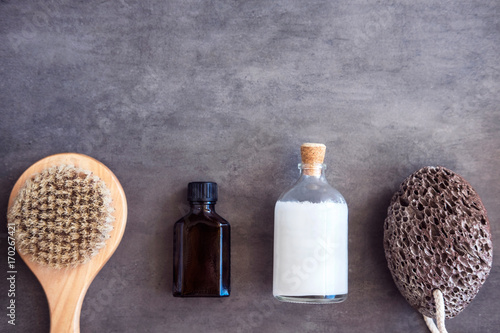 Fotobehang Spa SPA cosmetics, woman body and skincare products on gray. Top view