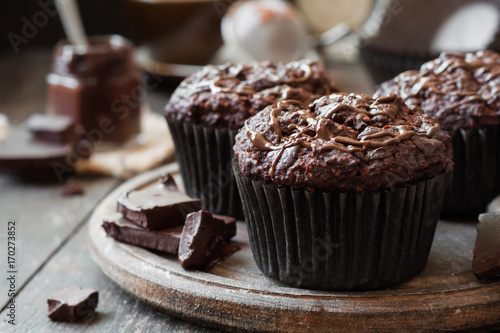 chocolate muffins on a wooden background