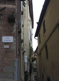Small ancient road between building in Lucca, Italy