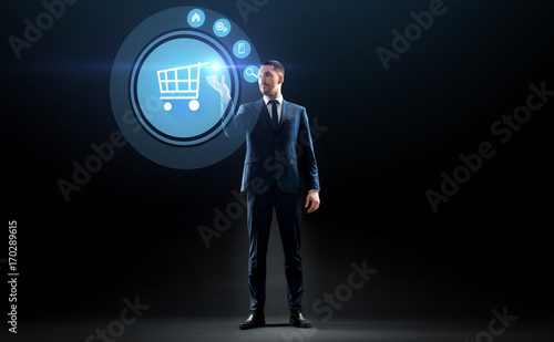 businessman with shopping cart on virtual screen