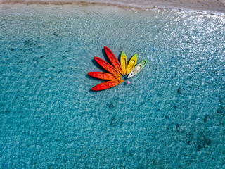 Canoe and kayaks like flower in Polynesia Cook Island tropical paradise aerial view