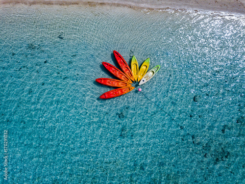 Fotobehang Tropical strand Canoe and kayaks like flower in Polynesia Cook Island tropical paradise aerial view