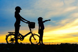 Silhouettes of biker family on the beach at beautiful sunset. - 170294872