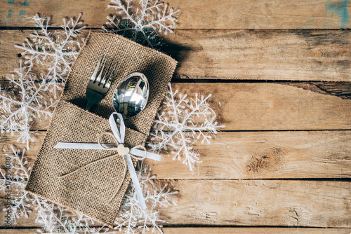 christmas table place setting and silverware, snowflakes on wooden background with space. - 170301088