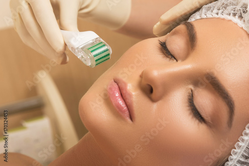 Beautiful woman in beauty salon during mesotherapy procedure.