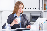 Business woman with coffee at workplace
