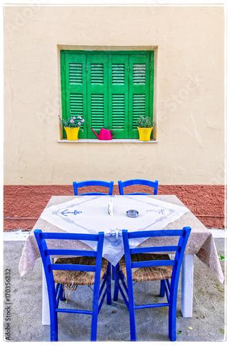 Fotobehang Freesurf Traditional street tavernas of Greece