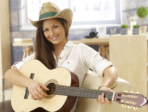 Portrait of happy female guitarist