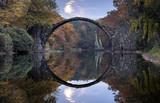 Devil's bridge in Kromlau in autumn coat