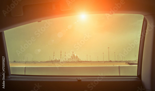 Foto op Plexiglas Abu Dhabi View from car window on the Mosque of Sheikh Zayed in Abu Dhabi,