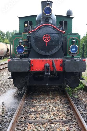 Restored historic steam engine on rail track