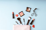 Fototapety Set of Makeup cosmetics products with bag on top view, vintage style