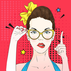 Pop art surprised woman face with a finger raised and holds cat's eye glasses. Vector illustration.