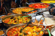 Variety of cooked curries on display at Camden Market in London