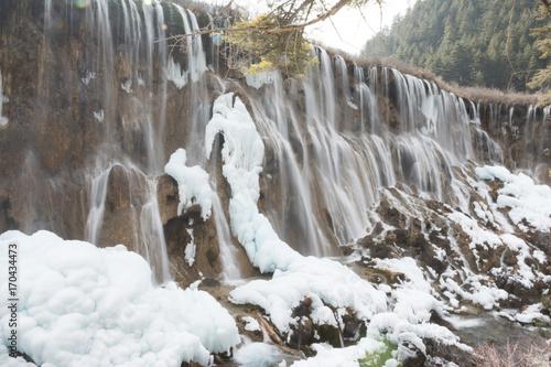 Fotobehang Grijs Frozen waterfall