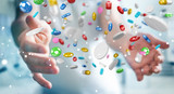 Businessman holding and touching floating medicine pills 3D rendering