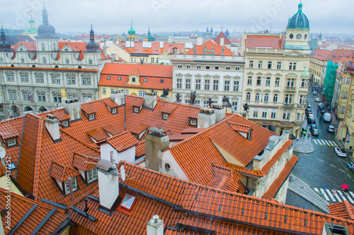Fotobehang Praag yellow roofs of old houses