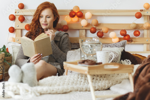 Woman eating gingerbread cookies - 170444648