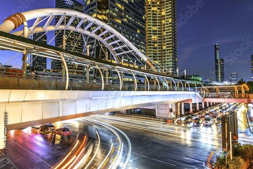 Foto op Plexiglas Nacht snelweg raffic lighting on Sathorn road, Business center of Bangkok,Thailand.