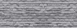 banner brick wall covered with neutral gray lime