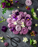 composition of various blueberry meringues and pansies and jusmine flowers