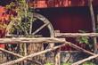 Wheel Against Barn
