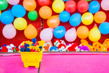 Colorful Darts, Balloons, and Stuffed Animal Prizes in an Amusement Park