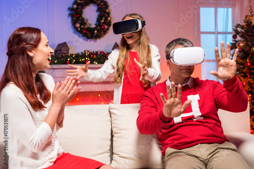 family in vr goggles on christmas