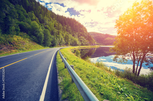 Driving a car on a mountain road along the fjord. Nature Norway