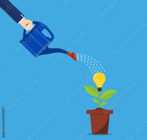 Hand of business person watering idea tree. - 170534057