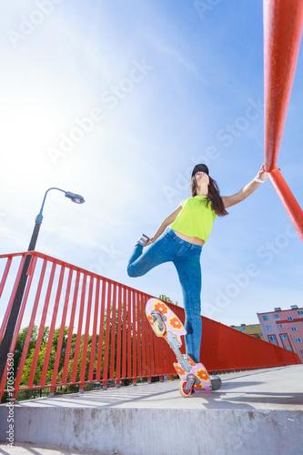 Fotobehang Skateboard Teen girl skater riding skateboard on street.