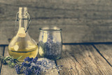Essential lavender oil for aromatherapy and sea salt for bath, body care, spa and massage concept