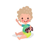 Cute little boy sitting on the floor playing with toy car cartoon vector Illustration