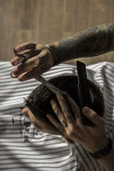 close up of men's hairstyling and haircutting in a barber shop .