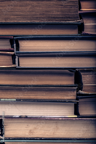 a stack of old tattered books плакат