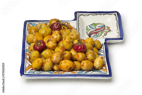 Moroccan pickled olives on a ceramic olive dish