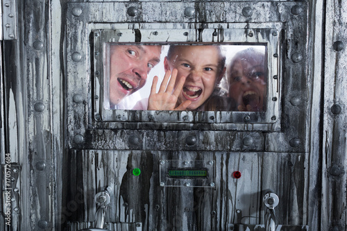 Portrait of a mad father with children who are behind a closed door Poster