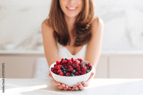 Close up portrait of smiling girl holding bowl