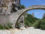 kokkori arched stone bridge Zagoria Epirus Greece - 170584099