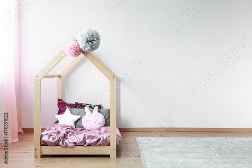 Bed with pink satin bedding