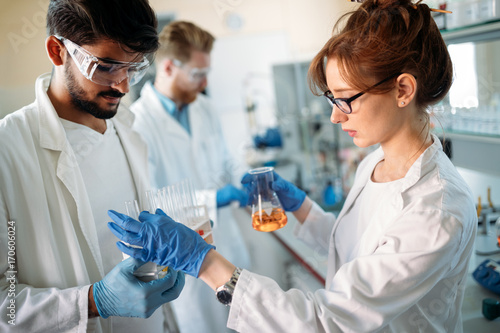 Young students of chemistry working in laboratory
