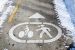 Symbols Painted on Asphalt of a Pedestrian and Bicycle Path in Winter. The Snow was Cleared from the Path.