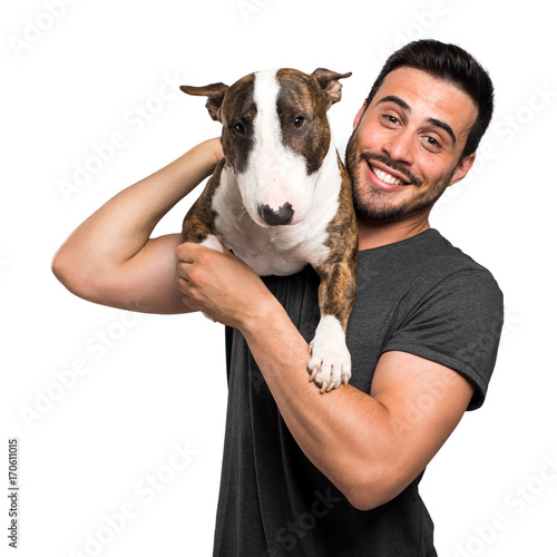 Man holding his dog on a shoulder Poster